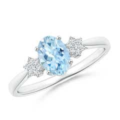 Oval Aquamarine Solitaire Ring with Diamond Clusters