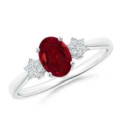 Tapered Oval Garnet Solitaire Ring with Diamond Clusters
