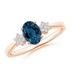 Oval London Blue Topaz Solitaire Ring with Diamond Clusters