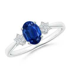 Tapered Oval Sapphire Solitaire Ring with Diamond Clusters