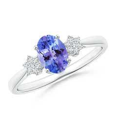 Tapered Oval Tanzanite Solitaire Ring with Diamond Clusters