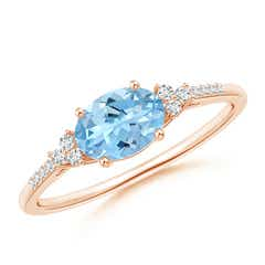 Horizontally Set Oval Aquamarine Solitaire Ring with Trio Diamond Accents