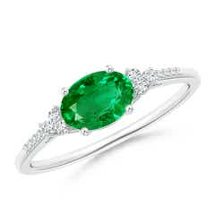 Horizontally Set Oval Emerald Solitaire Ring with Trio Diamond Accents