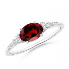 Horizontally Set Oval Garnet Solitaire Ring with Trio Diamond Accents