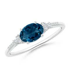 Horizontally Set Oval London Blue Topaz Ring with Diamonds