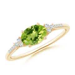 Horizontally Set Oval Peridot Solitaire Ring with Trio Diamond Accents