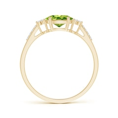 Toggle Horizontally Set Oval Peridot Solitaire Ring with Trio Diamond Accents