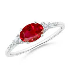 Horizontally Set Oval Ruby Solitaire Ring with Trio Diamond Accents