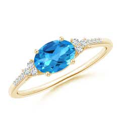 Horizontally Set Oval Swiss Blue Topaz Ring with Trio Diamonds