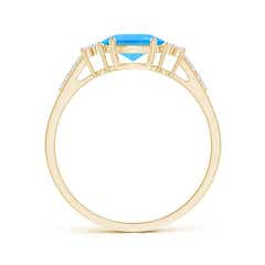 Toggle Horizontally Set Oval Swiss Blue Topaz Ring with Trio Diamonds