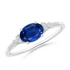 Horizontally Set Oval Sapphire Solitaire Ring with Trio Diamond Accents