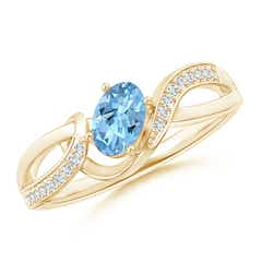 Solitaire Oval Aquamarine Twisted Ribbon Ring with Pave Diamond Accents
