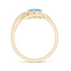Toggle Solitaire Oval Aquamarine Twisted Ribbon Ring with Pave Diamond Accents