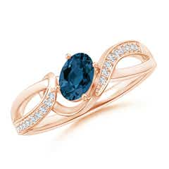 Oval London Blue Topaz Twisted Ribbon Ring with Diamonds