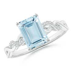 Solitaire Emerald Cut Aquamarine and Diamond Infinity Twist Ring