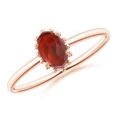 Classic Oval Garnet Ring with Beaded Halo
