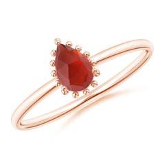 Pear-Shaped Garnet Beaded Halo Ring
