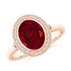 Bezel Set Oval Garnet Ring with Diamond Halo
