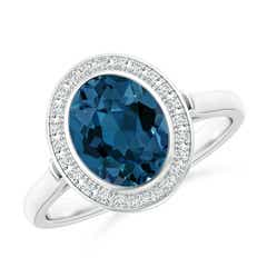 Bezel Set Oval London Blue Topaz Ring with Diamond Halo