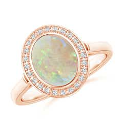Bezel-Set Oval Opal Ring with Diamond Halo