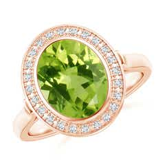 Bezel-Set Oval Peridot Ring with Diamond Halo