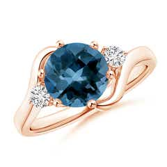 Round London Blue Topaz and Diamond Three Stone Bypass Ring