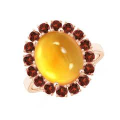 Oval Cabochon Citrine and Garnet Halo Ring