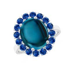 Oval Cabochon London Blue Topaz and Sapphire Halo Ring