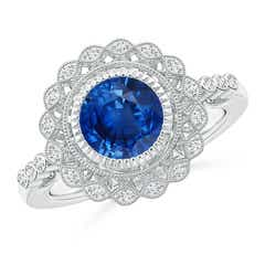 Angara Classic Oval Tanzanite Solitaire Ring With Petal Motifs in White Gold