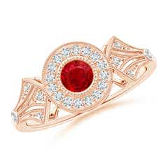 Ruby and Diamond Halo Engagement Ring with Kite Motifs