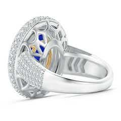 Toggle GIA Certified Oval Tanzanite and Diamond Triple Halo Ring