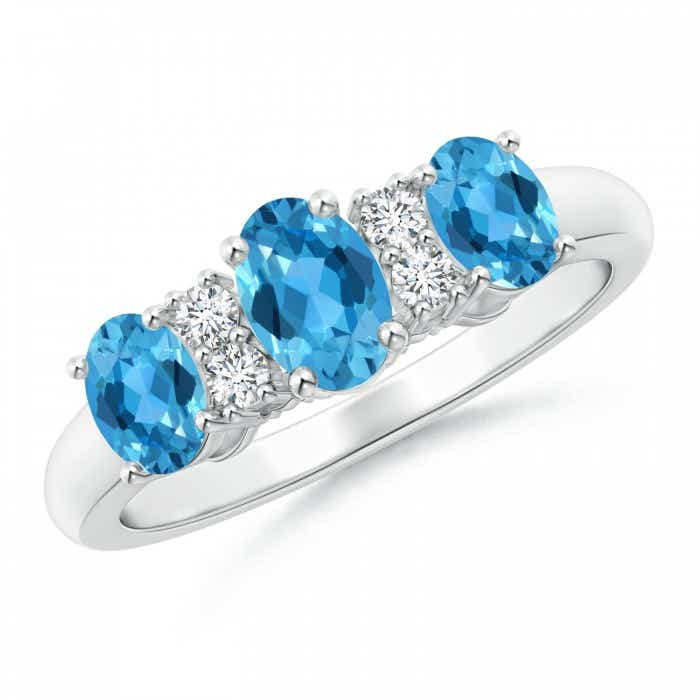 Angara Three Stone Swiss Blue Topaz Diamond Ring in Platinum