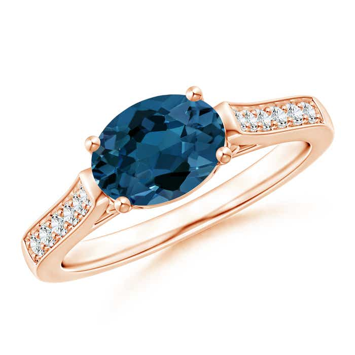 Angara London Blue Topaz Solitaire Ring with Diamond in Yellow Gold PUSKm