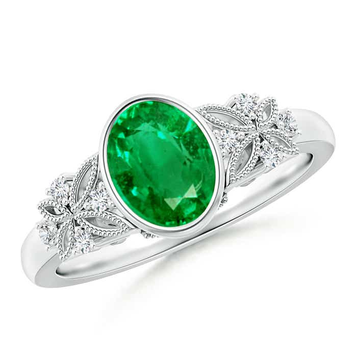 bezel set vintage oval emerald ring with accents