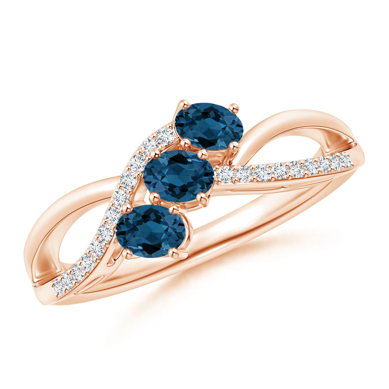 Oval London Blue Topaz Three Stone Bypass Ring with Diamonds - Angara.com