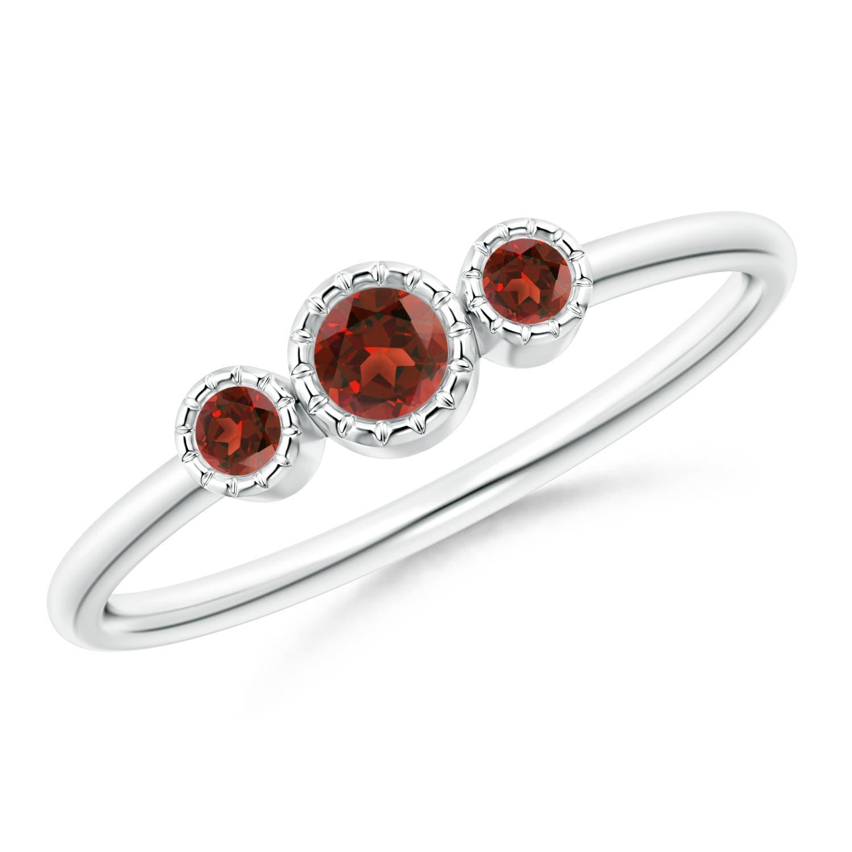 Bezel Set Round Garnet Three Stone Ring | Angara